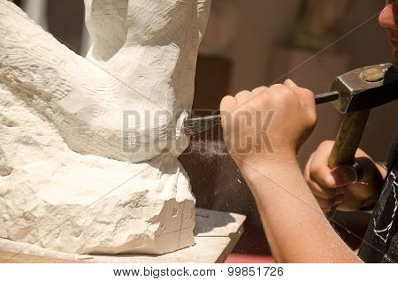 Man with hammer working