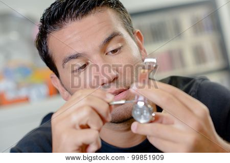 Man repairing his watch