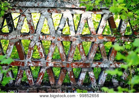 world of noble estate: geometric pattern from a brick fence in the park