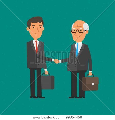 Young and old businessman shake hands
