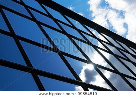 Reflection Of The Sky And Clouds In The Windows Of  Building