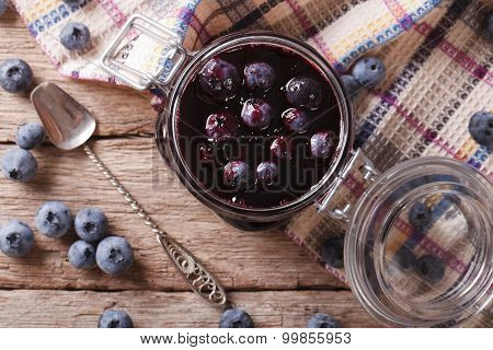 Fresh Blueberry Marmalade In A Glass Jar Close Up. Horizontal Top View