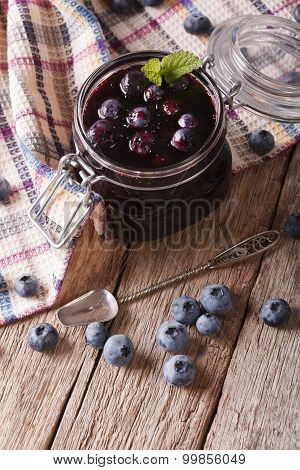 Fresh Blueberry Marmalade In A Glass Jar Close Up. Vertical