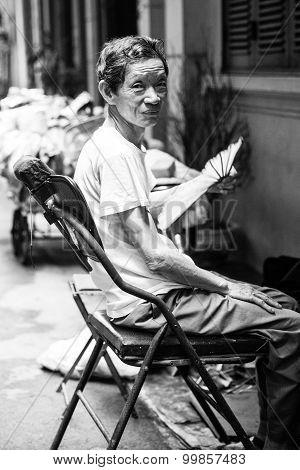 Vietnamese senior man restnig on his chair, Hanoi