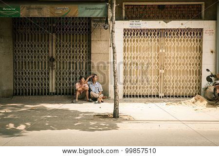 ietnamese men resting in the shade on the street, Vietnam