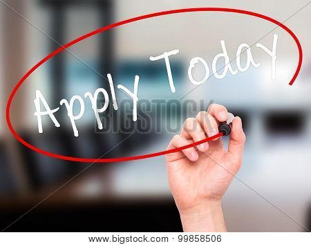 Man Hand writing Apply Today with black marker on visual screen.