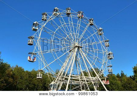 Ferris Wheel Against Bright Blue Sky