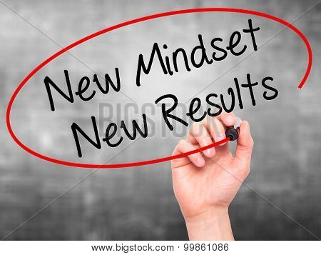 Man Hand writing New Mindset New Results with black marker on visual screen.