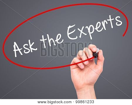 Man Hand writing Ask the Experts with black marker on visual screen.