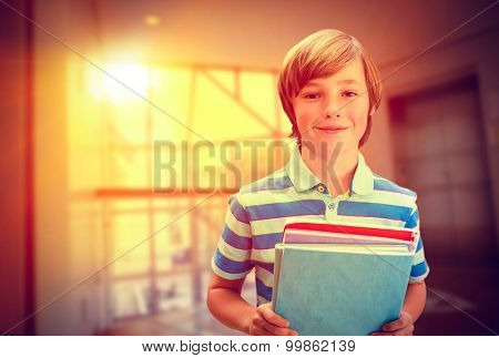 Cute pupil smiling at camera in library against foyer area with elevator