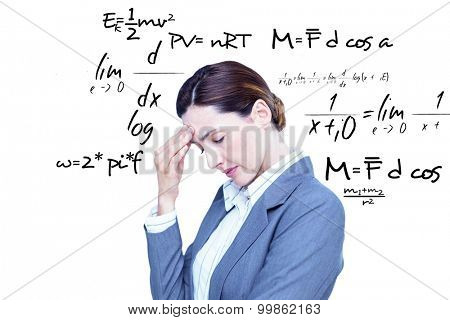 Concentrating businesswoman against maths equation