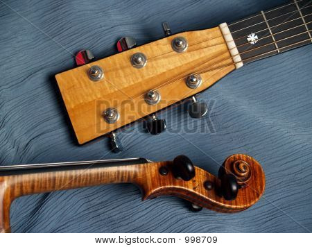 Violin And Guitar Heads On Blue