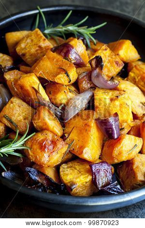 Roasted sweet potato with red onion and rosemary.