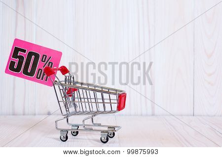 Shopping Cart With Tag Of Discount