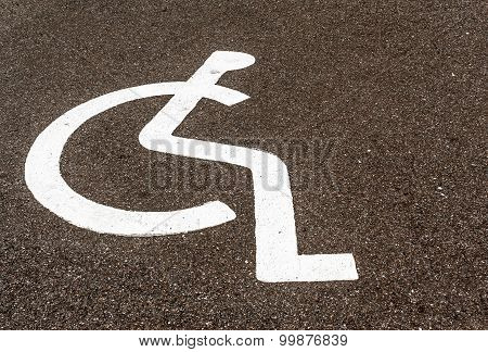 White Painted Disabled Parking Symbol On A Road