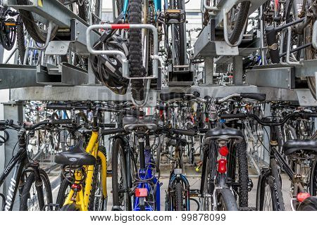 Stacked Rows Of Commuter Bikes At A Train Station