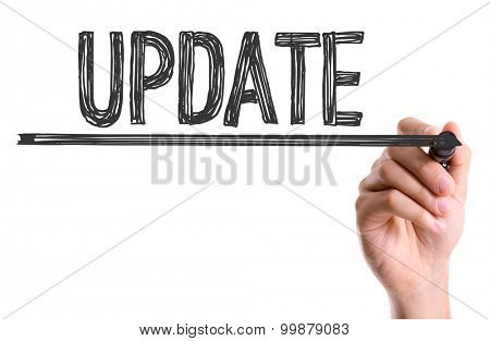 Hand with marker writing the word Update