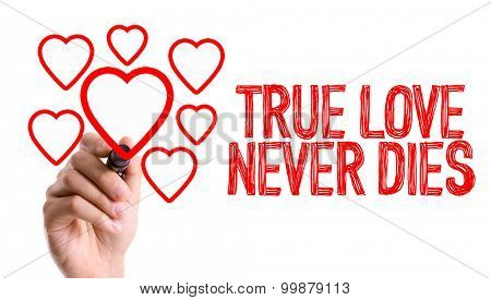 Hand with marker writing the word True Love Never Dies