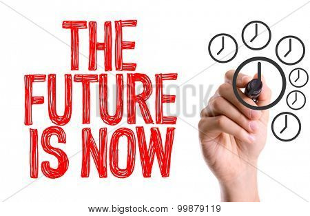 Hand with marker writing the word The Future is Now