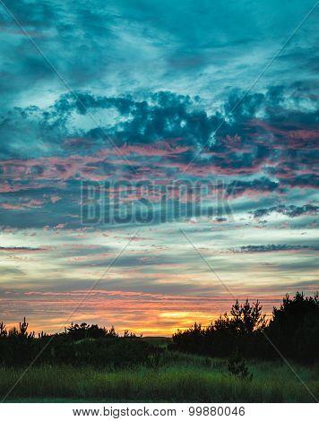 Blue and orange sunset over beachhead
