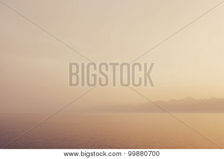 Scenery and sea mist abstract landscape with blurred water movement and subtle pastel colors .