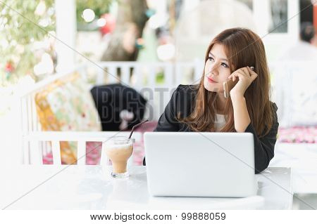 Asia Young Business Woman Sitting In A Cafe With Iced Coffee And Labtop, Call Phone
