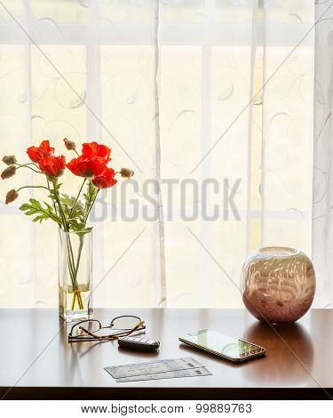 Pair Of Theater Tickets On Table With Window