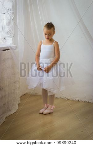 Cute Shy Little Ballerina Posing In Classical Tutu