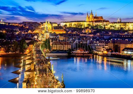 Prague Czech Republic. Charles Bridge and Hradcany (Prague Castle) with St. Vitus Cathedral and St. George church evening dusk Bohemia landmark in Praha.