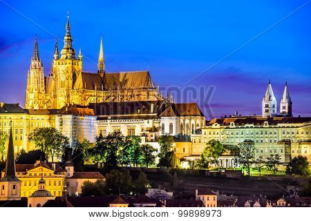 Prague Czech Republic. Hradcany (Prague Castle) with St. Vitus Cathedral and St. George church evening dusk Bohemia landmark in Praha.