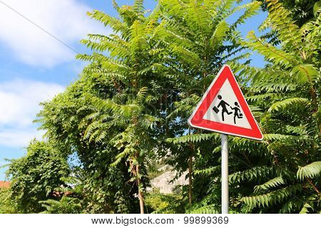 A traffic sign at School zone :  Children crossing