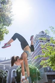 stock photo of parkour  - Woman doing parkour in the city on a sunny day - JPG