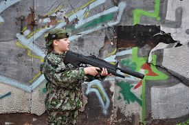 image of paintball  - boy teenager in camouflage and with equipment for paintball - JPG