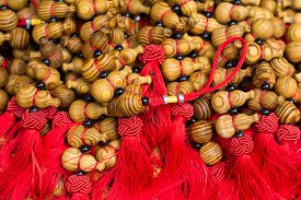 foto of calabash  - exquisite wooden calabash crafts with red Knottings