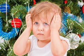 foto of sad christmas  - Portrait of upset and distraught little girl in white T - JPG