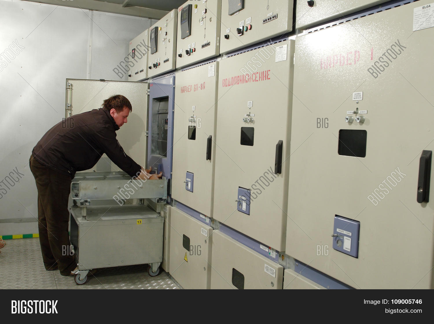 Electrician Provides Maintenance Of Electrical Panel In ...