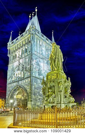 Tower On Charles Bridge At Nighttime. Czech Republic.