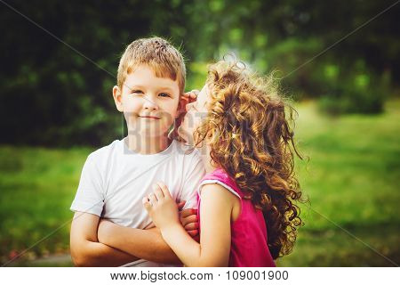 Little Boy And Girl Whispers.