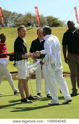 Tournament Presenter And Grand Master Gary Player Shaking Hands With Team Mate, Singer, Songwriter R