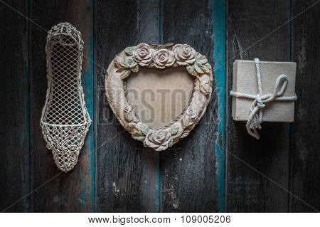 Photo Frame And Gift On Background.