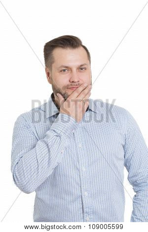 adult male with a beard. isolated on white background. hand covers her mouth. lips. gestures lie