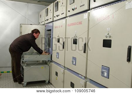 Electrician Provides Maintenance Of Electrical Panel In Switchboard Room.