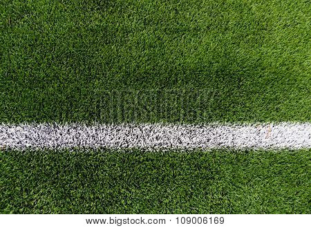 sport and game concept - close up of football field with line and grass