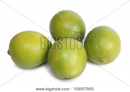 Fresh lemon stacked in rows on white background