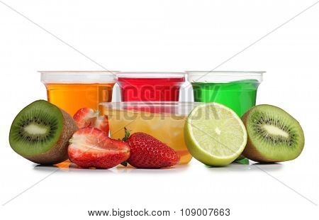 Jam in a glass with raw fruit on white background
