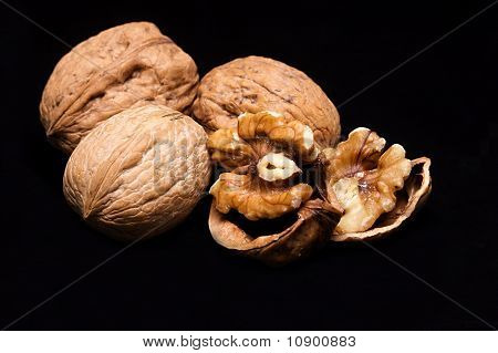 Walnuts In Shells On A Black Background