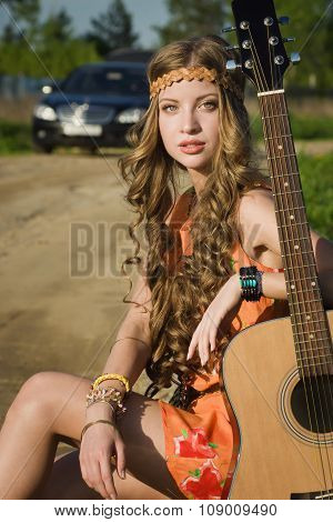 Hippie Girl Travelling  On A Road