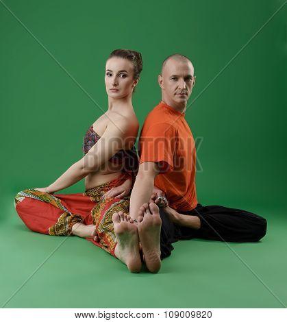 Yogis posing at camera while performing asana