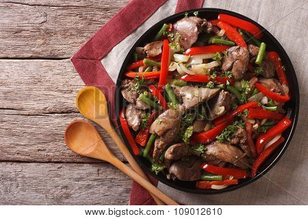Fried Chicken Liver  With Vegetables On A Dish. Horizontal Top View