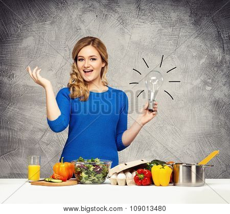 Young and beautiful housewife woman cooking. Kitchen ideas concept.